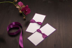 Composition with handmade cards and orchid flower in purple colo Royalty Free Stock Images