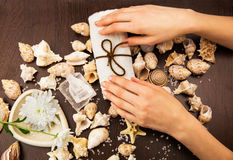 Composition with hands and seashells Stock Photo