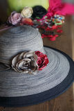 Composition the hat with fabric roses Stock Images