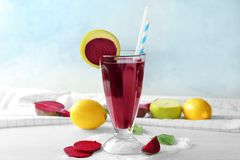 Composition with healthy beet smoothie in cocktail glass with straw. And some ingredients Royalty Free Stock Photo