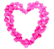 Composition of a heart with pink petals Royalty Free Stock Photos