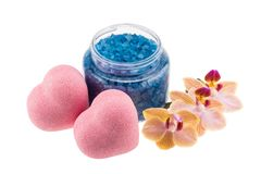 Composition of heart-shaped bath bombs, open bottle with blue se stock photo