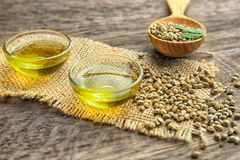 Composition with hemp oil and seeds. On wooden background royalty free stock photo