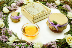 Composition of honey, grasses and flowers Royalty Free Stock Photo