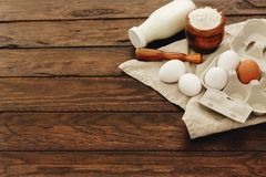 Composition with ingredients for baking over wooden background royalty free stock photos