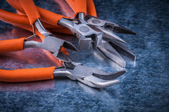 Composition of insulated cutting pliers gripping tongs with rubber handles Royalty Free Stock Image