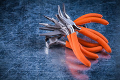 Composition of insulated electric gripping tongs nippers top vie Royalty Free Stock Images