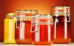 Composition with jars of honey Stock Images