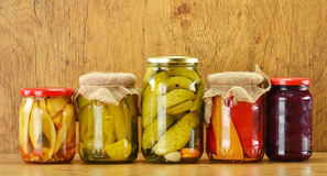 Composition with jars of pickled vegetables royalty free stock image