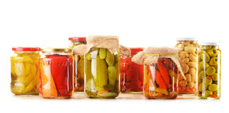 Composition with jars of pickled vegetables Stock Image