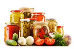 Composition with jars of pickled vegetables Stock Images