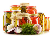 Composition with jars of pickled vegetables Stock Photos