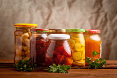 Composition with jars of pickled vegetables. Stock Photography