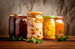 Composition with jars of pickled vegetables. Stock Images