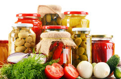 Composition with jars of pickled vegetables. Marinated food Stock Images