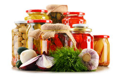 Composition with jars of pickled vegetables. Marinated food Stock Image