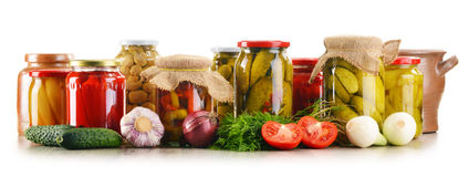 Composition with jars of pickled vegetables. Marinated food Royalty Free Stock Images
