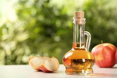 Composition with jug of apple vinegar on table. Space for text royalty free stock image