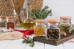 Composition of kitchen tools, spices and herbs. On white table Stock Image