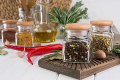 Composition of kitchen tools, spices and herbs. On white table Royalty Free Stock Photo