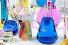 Composition of laboratory material with colored liquids in reali Royalty Free Stock Photo