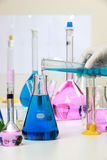 Composition of laboratory material with colored liquids in reali Royalty Free Stock Photography