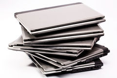 Composition of laptops. Pile of laptops on the white background royalty free stock photography
