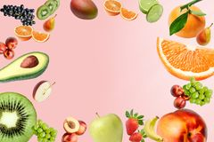 Composition with a large variety of different fruits throughout the field of the frame. Place for text in the middle. vector illustration