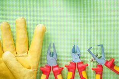 Composition of leather protective gloves insulation strippers ni Royalty Free Stock Images