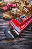 Composition of leather safety gloves brass plumbing equipment on Royalty Free Stock Photo