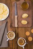 Composition with lemon tea on a wooden table Royalty Free Stock Photo