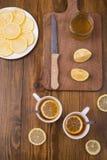 Composition with lemon tea on a wooden table Stock Photos
