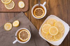 Composition with lemon tea on a wooden table Stock Images