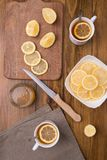 Composition with lemon tea on a wooden table Royalty Free Stock Photography