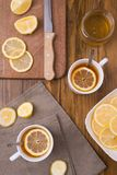 Composition with lemon tea on a wooden table Stock Photo