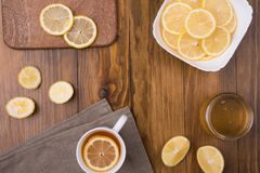Composition with lemon tea on a wooden table Stock Photography