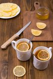 Composition with lemon tea on a wooden table Royalty Free Stock Image