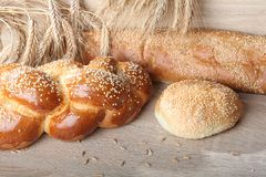 Composition with loaves of bread and rolls stock photo