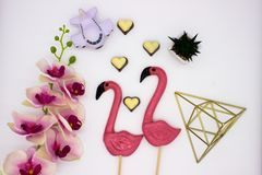 Composition from lollipops, chocolate hearts, pyramid, flower pot, and other decoration royalty free stock image
