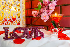 Composition with love plastic letters and candle Stock Image