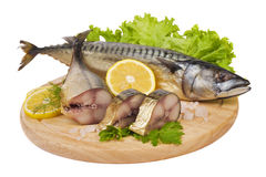 A composition with mackerel fish. On wooden plate isolated on white Stock Photos