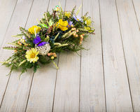 Composition made of artificial flowers, fruits, butterflies, birds and ears of wheat. Stock Photography