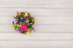 Composition made of artificial flowers, fruits, butterflies, birds and ears of wheat. Royalty Free Stock Photography