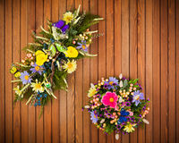 Composition made of artificial flowers, fruits, butterflies and ears of wheat. Royalty Free Stock Photography