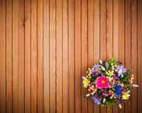 Composition made of artificial flowers, fruits, butterflies and ears of wheat. Stock Photography