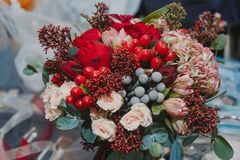 Autumn bridal bouquet, armful of heat in the hands. The composition, made in the autumn season, looks original and bright, regardless of the subject of the stock photo