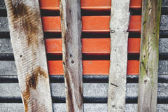 The composition made from an old metal sheets of roof and curved board Stock Photo
