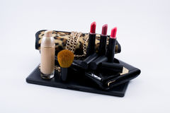 Composition make up accessories and a bag Stock Photo