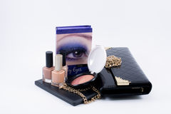 Composition make up accessories and a bag Stock Photos