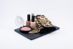 Composition make up accessories and a bag Stock Images